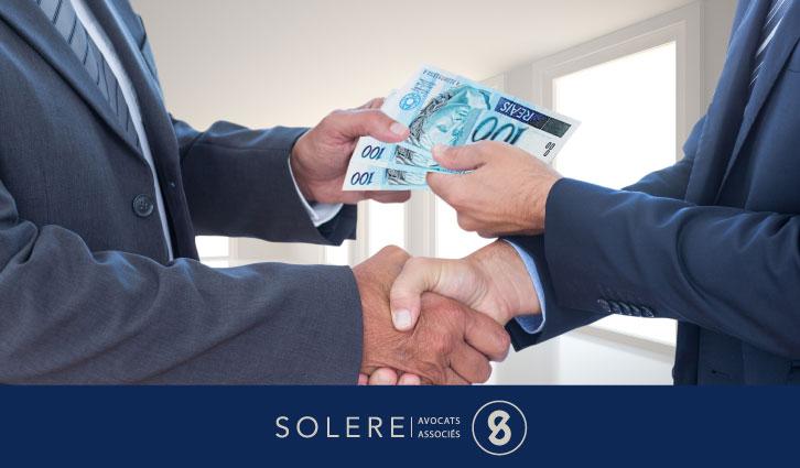 """Image qui montre deux personnes qui sécouent les mains pour l'article du Blog Solere intitulé: """"La Corruption au Brésil"""""""